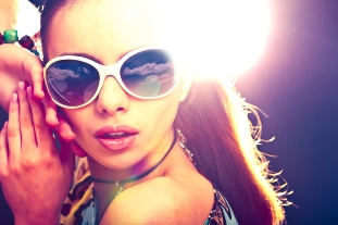 image of young woman in sunglasses